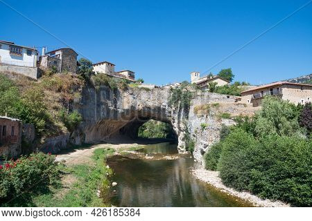 Beautiful View Of Puentedey, A Picturesque Village With A Natural Bridge Over The River. Merindades,
