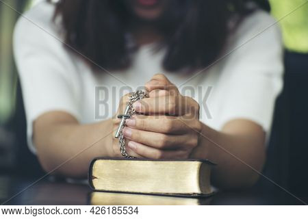 Prayer And Bible Concept. Asian Female Praying, Hope For Peace And Free From Coronavirus, Hand In Ha