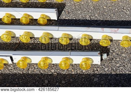 Illumination From A Variety Of Yellow Led Lamps. Small Yellow Light Bulbs Attached To A Metal Panel.