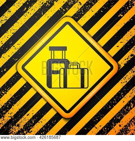 Black Suitcase For Travel Icon Isolated On Yellow Background. Traveling Baggage Sign. Travel Luggage