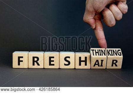 Fresh Thinking And Air Symbol. Businessman Turns Wooden Cubes And Changes Words Fresh Thinking To Fr