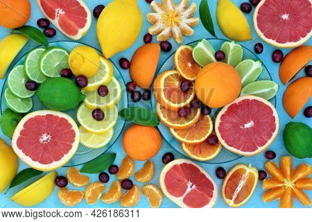 Sunshine citrus fruit high in antioxidants with oranges, lemons, limes and grapefruit also high in anthocyanins, lycopene, fibre and vitamin c. Health care concept to boost the immune system.