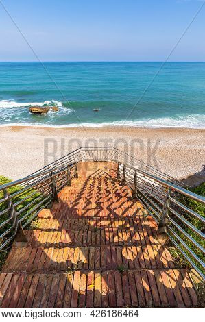 Stairs Leading Down To The Beach In Spain