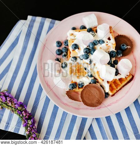 Blueberry and marshmallows over crispy extra everything waffles