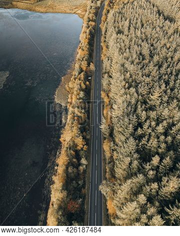 Aerial view of country road in Scottish highlands