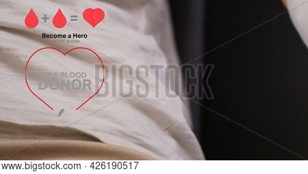 Blood donation text and icon against mid section of person donating blood at hospital. healthcare and blood donation concept