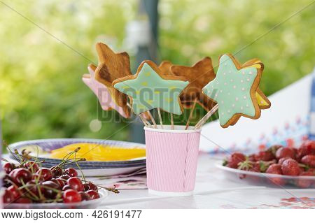 Colorful Dessert Table For Child Birthday, Party Table With Star Gingerbread And Berries Close Up