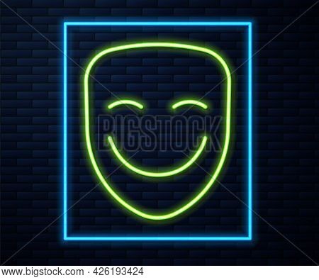 Glowing Neon Line Comedy Theatrical Mask Icon Isolated On Brick Wall Background. Vector