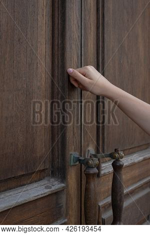 A Woman's Hand Knocking On A Closed Wooden Door, Surprise Visit, Closed, Is Anyone At Home?