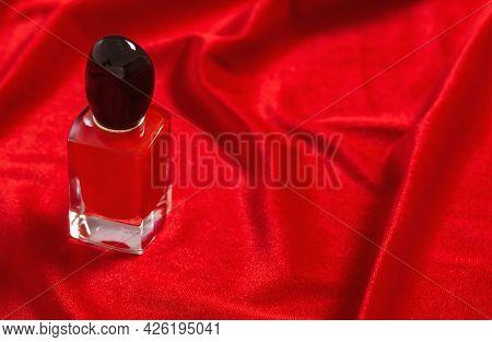 Red Perfume Bottle On Velvet Red Background