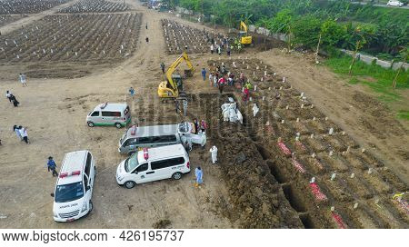 Aerial View Of Funeral Procession At Rorotan, North Jakarta. Special Graves Infected With The Corona