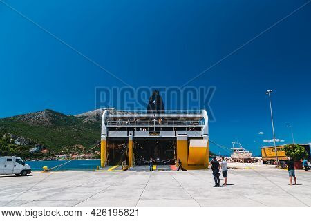 Poros, Cephalonia Island, Greece - July, 17 2019: An Embarkation Of Cars And Passengers At A Ferry B