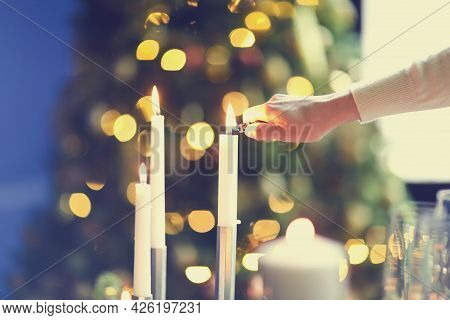 Unrecognizable Female Smiling And Igniting Candles While Creating Romantic Mood In Evening At Home