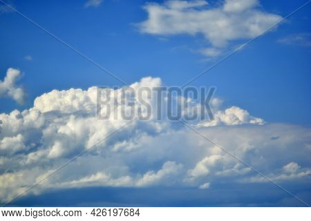 Blue And White Cumulus Clouds Before A Thunderstorm
