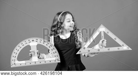 Learn Mathematics. Theorems And Axioms. Smart And Clever Concept. Girl With Big Ruler. School Studen