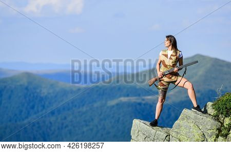 Military Female. Army Forces. Woman Military Outfit Hold Weapon Highlands Background. Girl Military