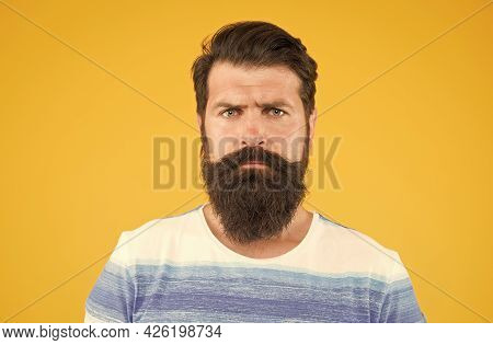 Bend His Brows. Serious Stylish Man With Moustache. Thinking Brutal Bearded Man On Yellow Background