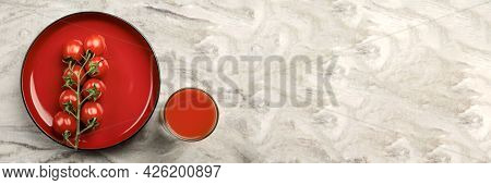 A Glass Of Tomato Juice And A Branch Of Small Tomatoes Banner. Cherry Tomatoes In A Red Plate On A M
