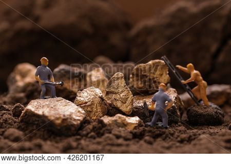 Miniature Worker Mining Stone, Metal, Gold, Lead, Copper, Zinc And Silver. Mining Business Or Depart
