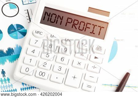Text Non Profit On Calculating Machine. Business Concept. Top View.