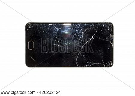 Smartphone With A Broken Screen On A White Background Top View.a Broken Smartphone With A Cracked Gl