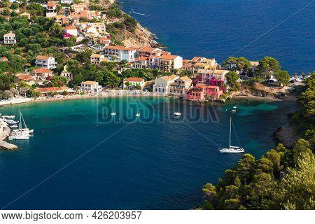 Close Up Top View At Asos Village, Assos Peninsula And Fantastic Turquoise And Blue Ionian Sea Water