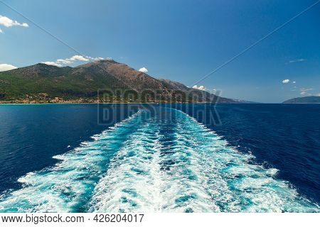 Bright Sea Water Trail Behind A Cruise Ship Summer Time. Ferry Boat Leaves A Trail In A Blue And Cle