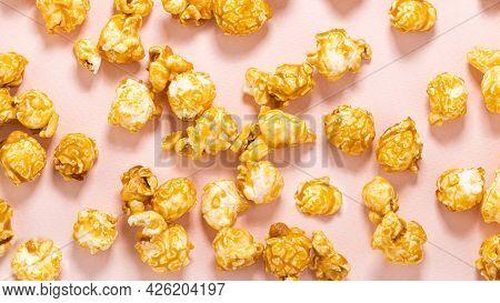 Caramel Popcorn On A Pastel Pink Background.
