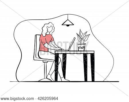 Woman Working At Her Desk At Home