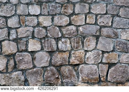 Masonry Rock Wall Texture. Texture Of A Stone Wall. Part Of Old Castle Stone Wall Background. Graysh