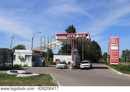 Russia, Saint Petersburg, July 6, 2021. Photo Of A Lukoil Gas Station With Cars And People Pouring G