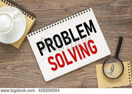 Problem Solving. Text On Wood Table, On White Paper
