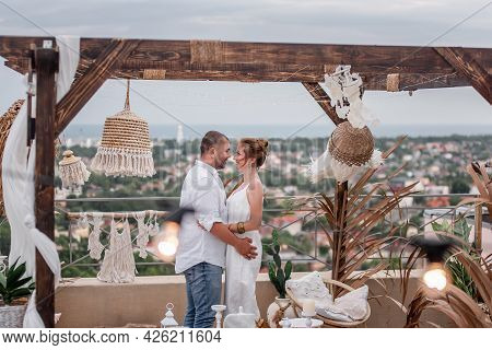 Loving, Happy Middle-aged Couple Hugs On The Open Terrace Of The Roof Of High-rise Building Overlook