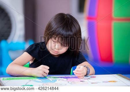 Cute Asian Girl Is Making Art Drawing And Painting A Story About Herself And Her Sister On Paper. Ch