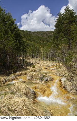 Mountain River Of Crystalline Waters On A Bed Of Yellow Stones And Dry Grasses, Sorradipara Canyon,