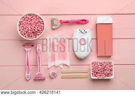 Set Of Epilation Products On Pink Wooden Table, Flat Lay