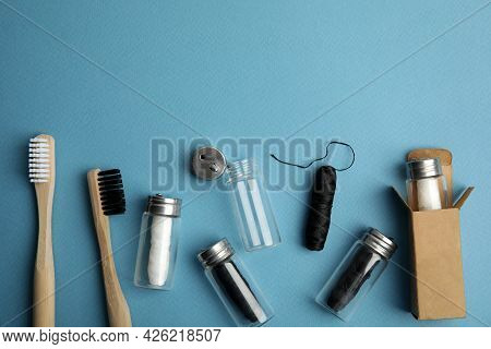 Flat Lay Composition With Natural Dental Floss On Light Blue Background. Space For Text