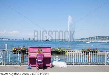 Geneva, Switzerland - June 19, 2017: Female Woman, Amateur Pianist, Playing Piano In Front Of Lake G