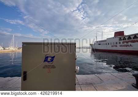 Rijeka, Croatia - June 17, 2021: Logo Of Lucka Uprava Rijeka On One Of Their Quays With Ships In Bac