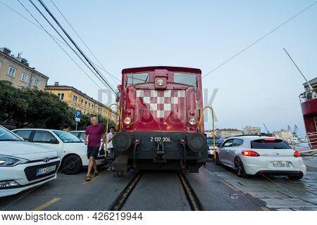 Rijeka, Croatia - June 18, 2021: Switcher, A Diesel Locomotive, Manoeuvering A Freight Train From Hz
