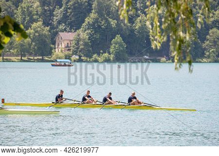 Bled, Slovenia - June 13, 2021: Four Young Male Adults, Rowers, On A Coxed Four, A Rowing Boat, Trai