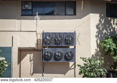 Venting Fans And Compressor Unit Fans On An Hvac Unit, Commercial Grade, On An Industrial Building,