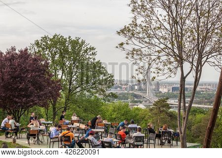 Belgrade, Serbia - May 2, 2021: Aerial View Of Belgrade And Ada Most Bridge In Front Of A Cafe Bar P