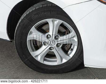 Novosibirsk, Russia - June 29, 2021: Mazda 3,  Close Up Of The Car Front Detail With  Light-alloy Wh
