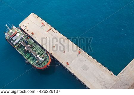 Tanker Ship With Green Deck Is Moored In Jedda Port On A Sunny Day, Saudi Arabia. Aerial View