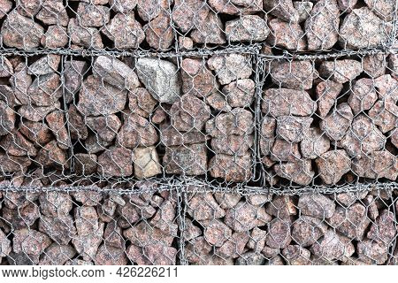 Gabion Structure. Cage Boxes Filled With Rocks For Use In Civil Engineering, Road Building, Military