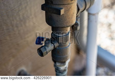 Test Cocks, Shut Off Valves, And Vacuum Breaker To A Lawn Sprinkler Irrigation System On The Outside