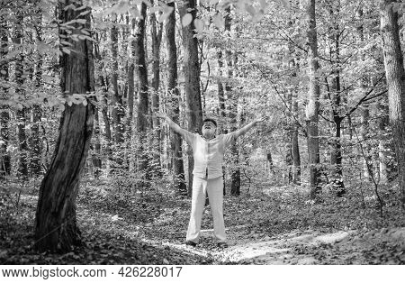 Desire For Freedom. Old Man Enjoy Freedom In Nature. Happy Pensioner Spread Arms In Wood. Leisure An