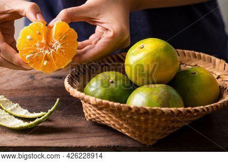 Woman Hand Peeled Green Tangerine Orange Fruit And Eating, Healthy Fruit
