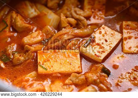 Close Up Of Kimchi Soup With Pork And Tofu In Cooking Pot, Korean Food